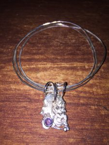 31 Sterling Silver Bangles with Tanzanite Charm